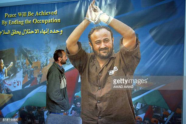 Palestinian Mukbel Barghuti brother of Fatah's jailed leader and Palestinian Authority presidential candidate Marwan Barghuti stands in front of a...