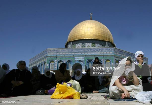 Palestinian Muslim female worshippers pray at the AlAqsa mosque compound in Arab east Jerusalem on the first Friday of the holy fasting month of...