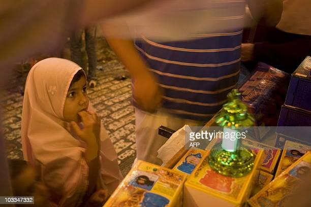 Palestinian Muslim girls hold traditional Ramadan lanterns while celebrating the at Jerusalem's old city after breaking the fast on the first day of...