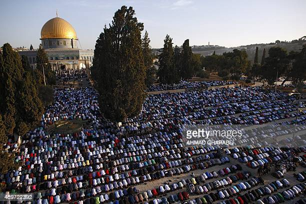 Palestinian Muslim worshipers pray on September 24 2015 at the alAqsa Mosque compound in Jerusalem's old city on the first day of Eid alAdha Eid...