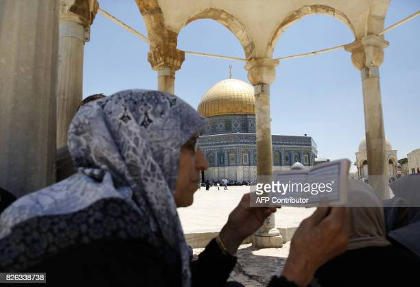 Palestinian Muslim worshippers attend Friday noon prayer near the Dome of the Rock mosque in the AlAqsa mosque compound in Jerusalem's old city on...