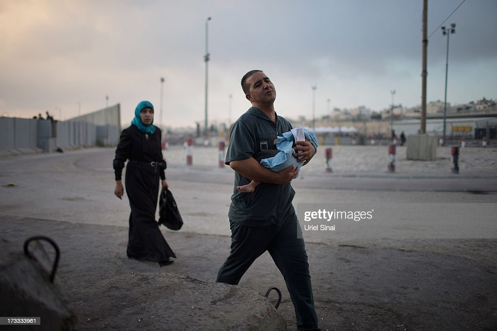 Palestinian Muslim worshippers cross the Qalandia checkpoint on their way to Jerusalem on July 12, 2013 near Ramallah, West Bank. Thousands of Palestinian worshippers crossed from the West Bank into Israel to attend the first Friday prayers of Ramadan at the the Al-Aqsa mosque compound in Jerusalem.