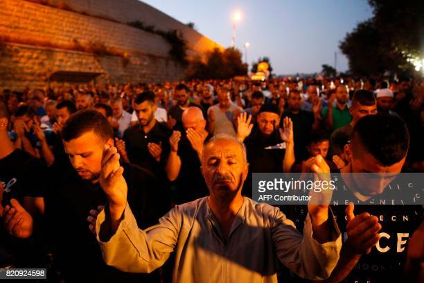 TOPSHOT Palestinian Muslim worshippers pray outside Lions' Gate a main entrance to the AlAqsa mosque compound in Jerusalem's Old City on July 22 in...