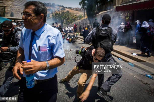 Palestinian Muslims clash outside the entrance to the old city of Jerusalem as it is partially blocked by Israeli Police on July 19 2017 in Jerusalem...