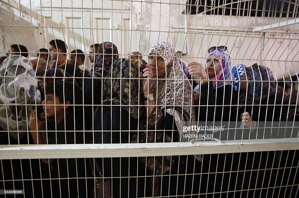Palestinian Muslims heading to pray at a religious site known to Muslims as the Ibrahimi Mosque and to Jews as the Cave of the Patriarchs, wait at an Israeli checkpoint in the flashpoint city of Hebron, in the occupied West Bank, on July 1, 2016. A Palestinian woman attempted to stab an Israeli guard at a flashpoint West Bank shrine and was shot dead, Israeli police said, the third violent incident in two days. BADER