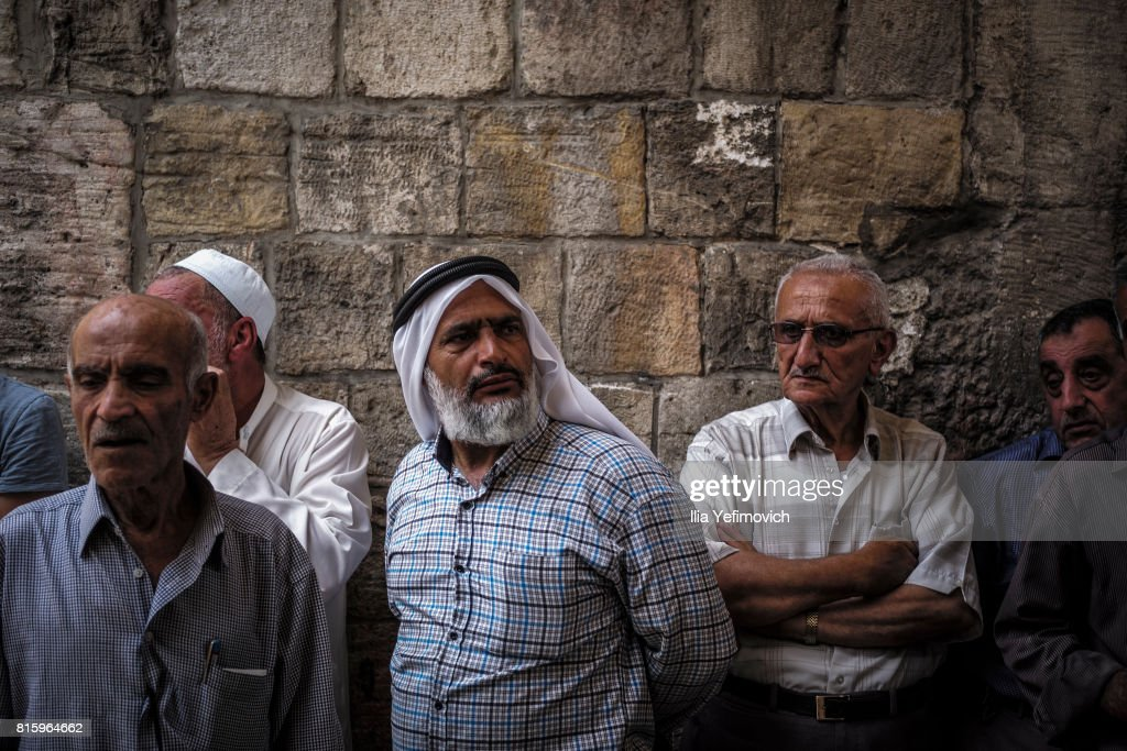 Palestinian Muslims outside the entrance to the old city of Jerusalem as it is partially blocked by Israeli Police on July 17, 2017 in Jerusalem, Israel. Following Friday's terror attack the holy site of Al Aqsa mosque was partly closed. Now only individuals can enter through metal detectors which has sparked outrage in the Muslim community.