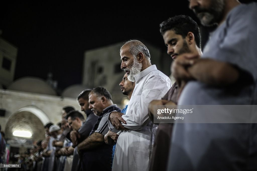 Palestinian Muslims pray on the occasion of Laylat al-Qadr, the night when the first verses of the Quran were revealed, at Seyyid Hasim Mosque in Gaza City, Gaza on July 2, 2016.