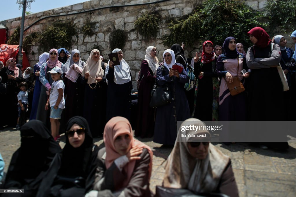 Palestinian Muslims protest praying outside the entrance to the old city of Jerusalem as it is partially blocked by Israeli Police on July 17, 2017 in Jerusalem, Israel. Following Friday's terror attack the holy site of Al Aqsa mosque was partly closed. Now only individuals can enter through metal detectors which has sparked outrage in the Muslim community.
