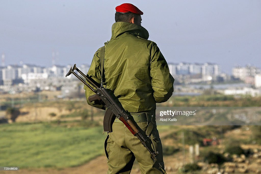 Palestinian national security man looks out from his post which was recently created in the Beit Lahyea Refugee Camp on March 20 2005 near the...