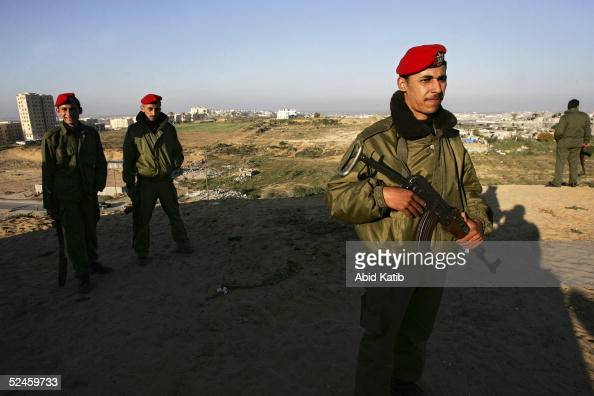 Palestinian national security men look out from their post which was recently created in the Beit Lahyea Refugee Camp on March 20 2005 near the...