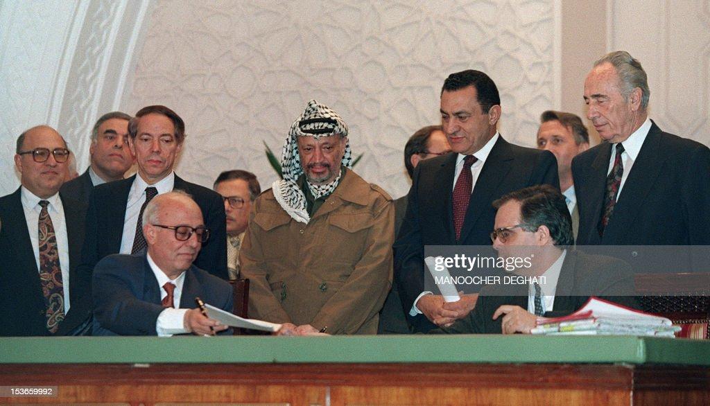 Palestinian negotiator Ahmed Qorei Abu Ala from Palestine Liberation Organization and Israeli diplomat Uri Savir both principal architects of the...