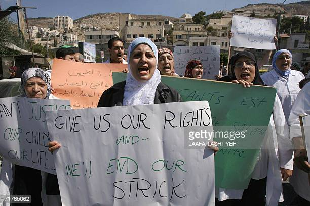 Palestinian nurses picket outside the local general hospital in the northern West Bank city of Nablus 06 September 2006 on the fourth day of a...