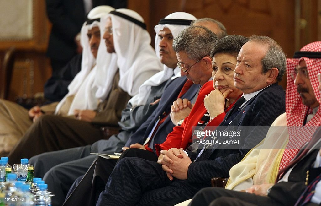 Palestinian official Hanan Ashrawi sits next to Egyptian tycoon Naguib Sawiris (2nd R) and Kuwait's former foreign minister, Sheikh Mohammed al-Sabah (R), during the opening ceremony of the first international conference of the Council of Arab and International Relations in Kuwait City on February 11, 2013. AFP PHOTO/YASSER AL-ZAYYAT