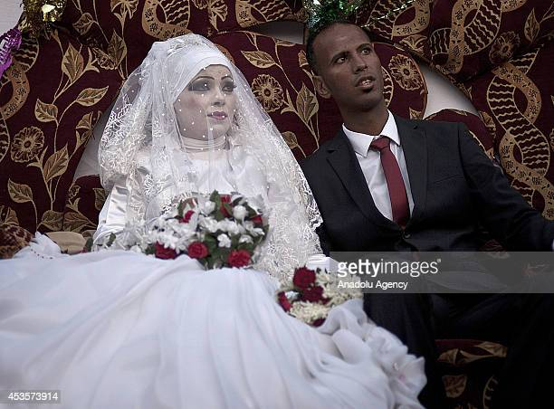 Palestinian Omar Abu Nemir taking shelter to UN Relief and Works Agency for Palestine Refugees in AlShati Camp due to Israeli assaults gets married...