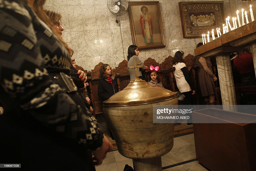 Palestinian Orthodox attend a mass during Christmas celebrations on January 7, 2013 in Gaza City. According to the Gregorian calendar, Orthodox Christmas falls 13 days after the December 25 Western feast celebrated in line with the Julian calendar. AFP PHOTO/MOHAMMED ABED
