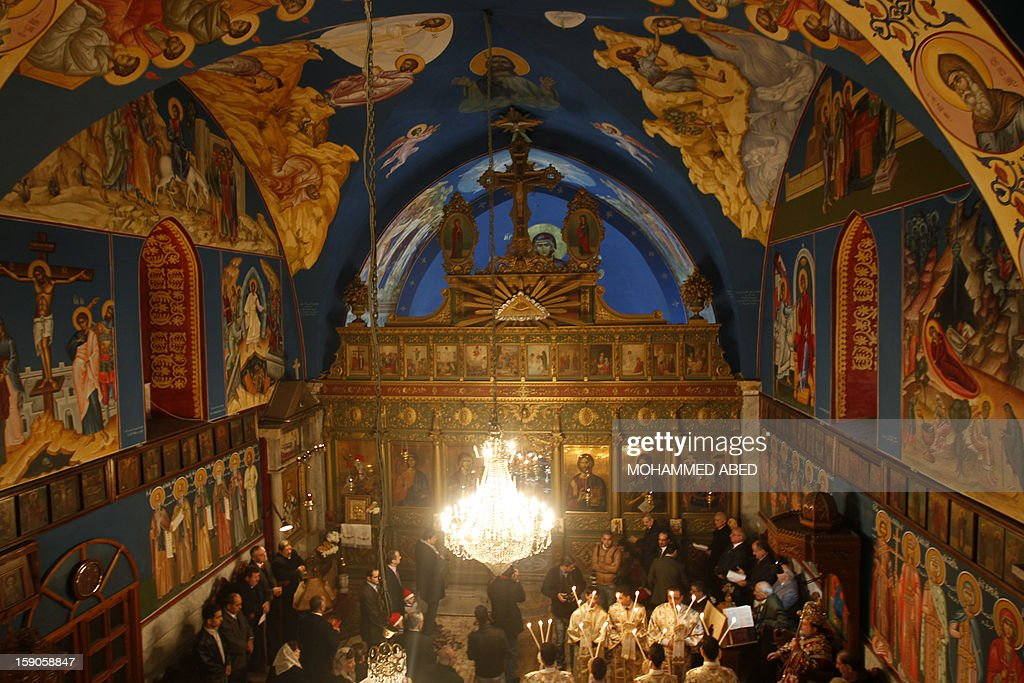 Palestinian Orthodox attend a mass in the Church of Saint-Porphyrius during Christmas celebrations on January 7, 2013 in Gaza City. According to the Gregorian calendar, Orthodox Christmas falls 13 days after the December 25 Western feast celebrated in line with the Julian calendar. AFP PHOTO/MOHAMMED ABED