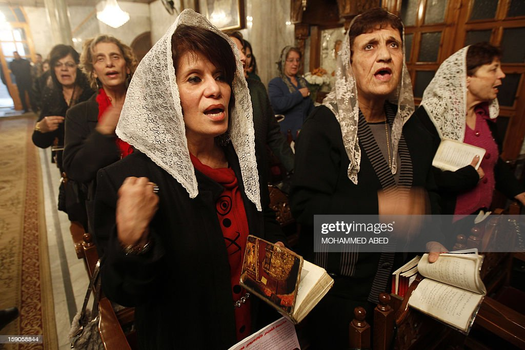 Palestinian Orthodox Christians attend a mass in the Church of Saint-Porphyrius as part of Christmas celebrations on January 7, 2013 in Gaza City. According to the Gregorian calendar, Orthodox Christmas falls 13 days after the December 25 Western feast celebrated in line with the Julian calendar. AFP PHOTO/MOHAMMED ABED