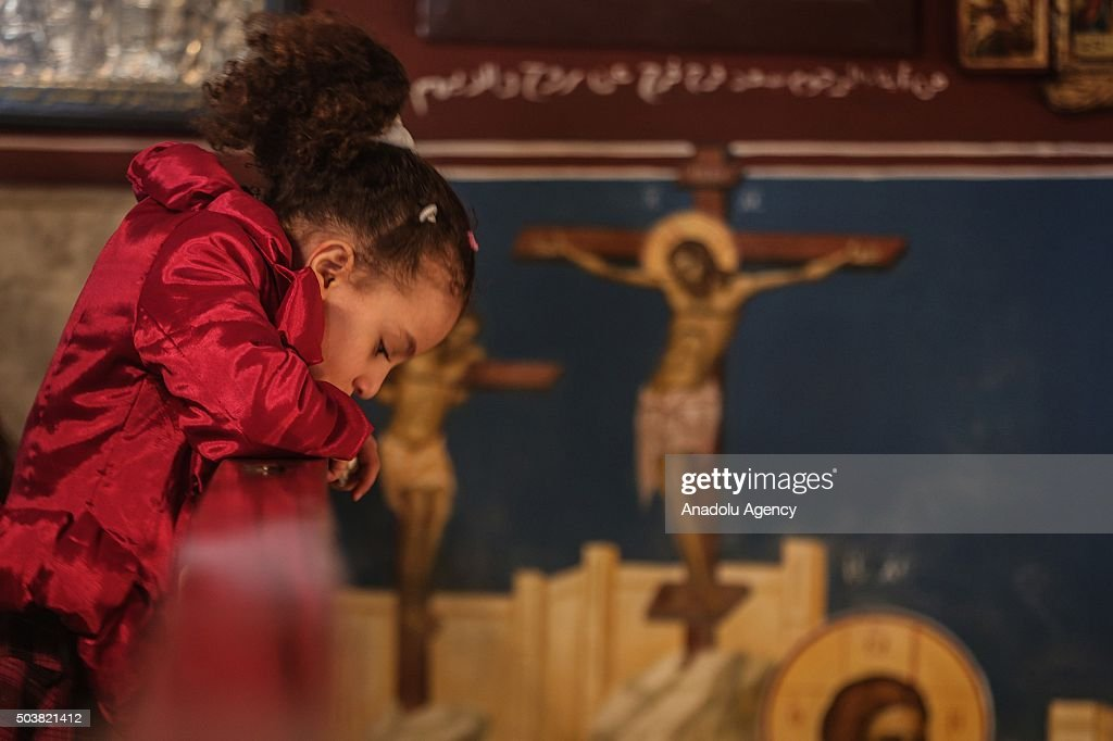 Palestinian Orthodox Christians attend an Orthodox Christmas mass led by Archbishop Alexios leads at the Greek Orthodox Church in Gaza City Gaza on...