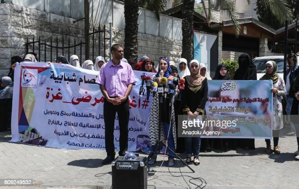 Palestinian people hold banners during a demonstration after a call of International Commission to Support Palestinian People's Rights to protest...