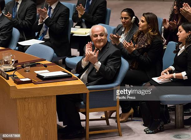 Palestinian Permanent Observer to the UN Riyad Mansour applauds following the passage of Resolution 2334 The United Nations Security Council held a...