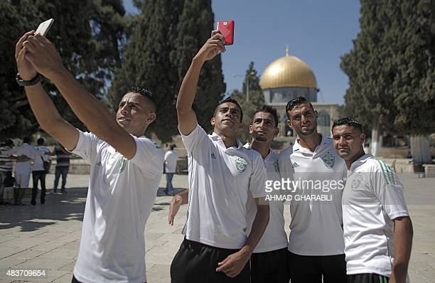 Palestinian players from Gaza City's Shejaiya football club take selfies outside the Dome of the Rock during their visit to the AlAqsa mosque...