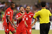 Palestinian players react after Ahmed Mahajna of Palestine recieved a yellow card during the 2015 Asian Cup match between Iraq and Palestine at...