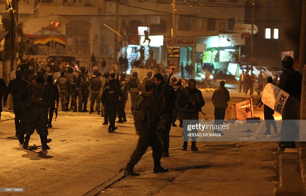 Palestinian police disperse a demonstration at the entrance of the Amaari refugee camp, close to the West Bank city of Ramallah, on January 20, 2013, as youths rallied to show solidarity with Palestinian prisoners, several of them from the refugee camp, after rumors spread that some prisoners were allegedly mistreated while being held in the Israeli Eshel prison. AFP PHOTO/ABBAS MOMANI