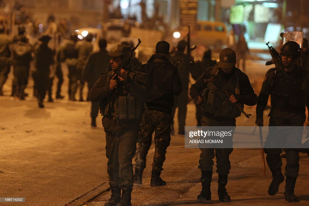 Palestinian police keep check after dispersing a demonstration at the entrance of the Amaari refugee camp, close to the West Bank city of Ramallah, on January 20, 2013, as youths rallied to show solidarity with Palestinian prisoners, several of them from the refugee camp, after rumors spread that some prisoners were allegedly mistreated while being held in the Israeli Eshel prison.