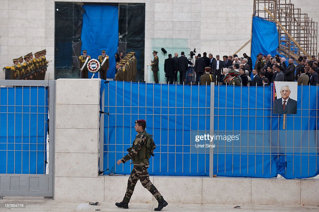 A Palestinian policeman patrols outside the mausoleum of Yasser Arafat during a ceremony on November 27, 2012 in Ramallah, West Bank. A team of investigators last night exhumed and reburied the body of former Palestinian leader Yasser Arafat in a bid to determine whether he was murdered by radiation poisoning. The new probe comes after traces of the deadly radioactive isotope, Polonium-210, were found on his clothing. Arafat died of unexplained causes in a French hospital in November 2004.