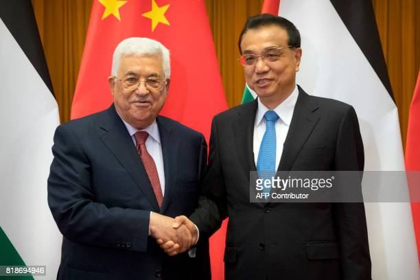 Palestinian President Mahmoud Abbas and Chinese Premier Li Keqiang pose for a photo before a meeting at the Great Hall of the People in Beijing on...