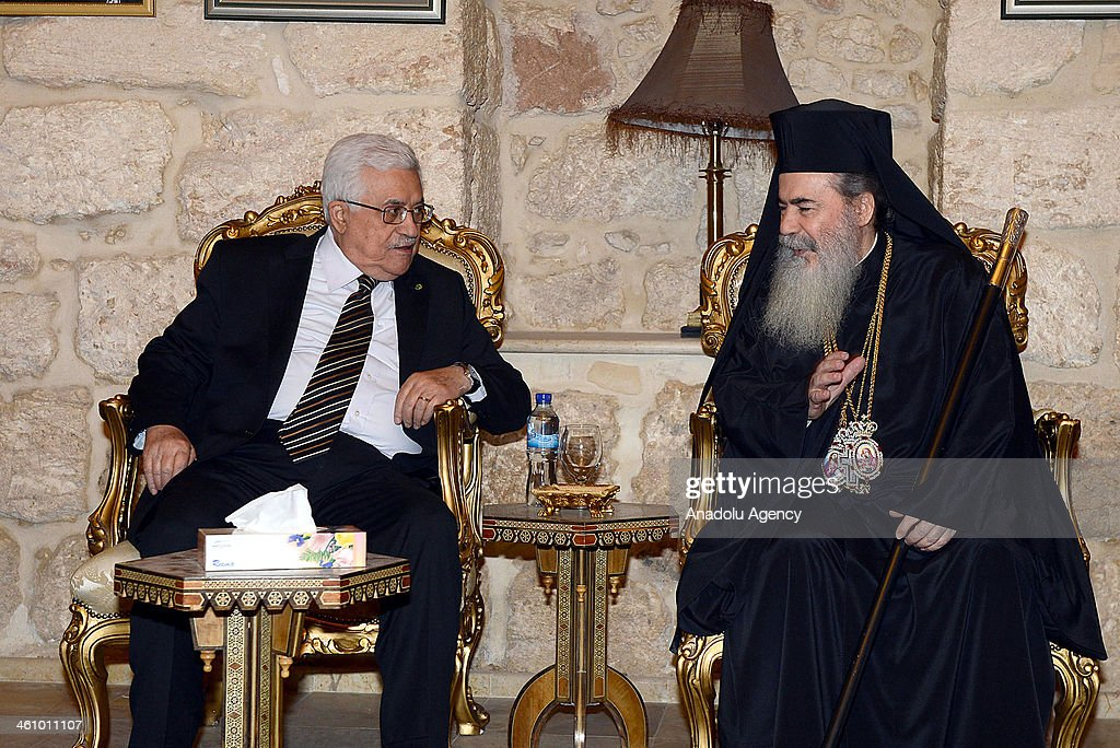 Palestinian President Mahmoud Abbas (L) and Greek Orthodox Patriarch Theophilos III (R) meet after Christmas mass at Nativity Church in Bethlehem, West Bank on January 6, 2014.