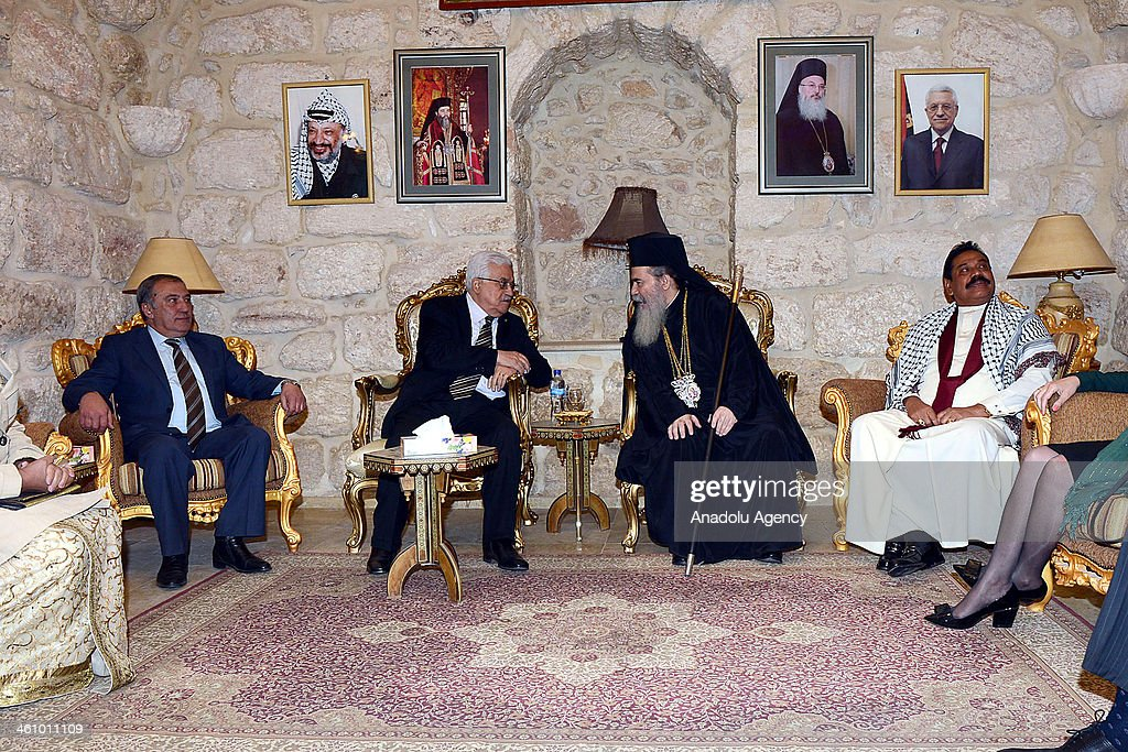 Palestinian President Mahmoud Abbas (2nd L) and Greek Orthodox Patriarch Theophilos III (2nd R) meet after Christmas mass at Nativity Church in Bethlehem, West Bank on January 6, 2014.