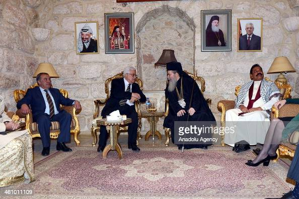 Palestinian President Mahmoud Abbas and Greek Orthodox Patriarch Theophilos III meet after Christmas mass at Nativity Church in Bethlehem West Bank...