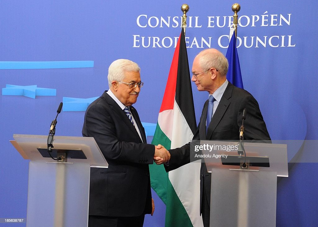 Palestinian President Mahmoud Abbas (L) and the President of the European Council Herman Van Rompuy shake hands during a press conference after a meeting at EU Council headquarters on October 23, 2013 in Brussels, Belgium.