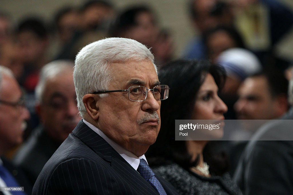 Palestinian President <a gi-track='captionPersonalityLinkClicked' href=/galleries/search?phrase=Mahmoud+Abbas&family=editorial&specificpeople=176534 ng-click='$event.stopPropagation()'>Mahmoud Abbas</a> attends the Christmas Midnight Mass in Saint Catherine's Church on December 25, 2012 in Bethlehem, West Bank. Thousands of pilgrims made their way to the Church of the Nativity this week to worship at the sacred site believed to be the birthplace of Jesus.