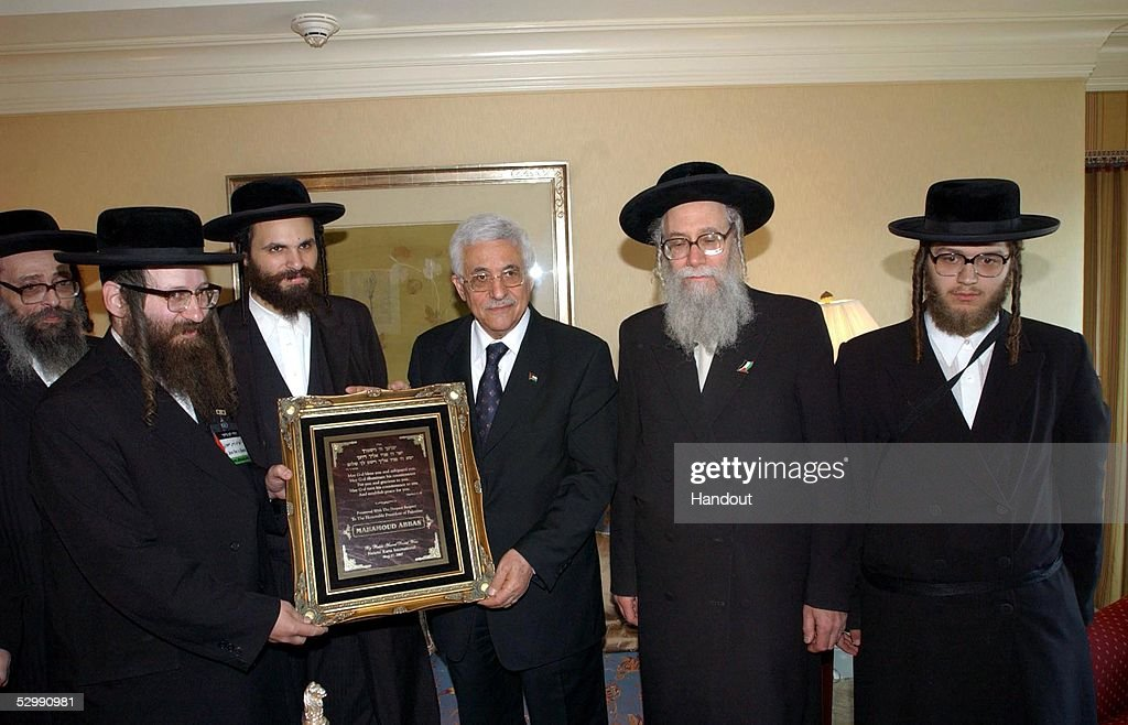 Palestinian President Mahmoud Abbas is presented a plaque by members of the fringe ultra-Ortodox, Jewish group Natori Karta May 27, 2005 in Washington, DC. The anti-Zionist Natori Karta advocates the dismantling of the state of Israel.