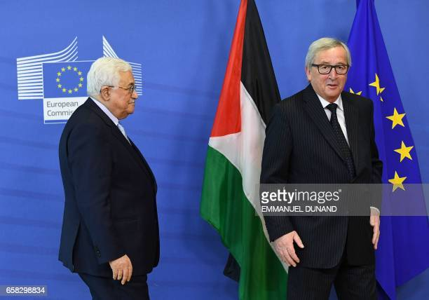 Palestinian President Mahmoud Abbas is welcomed by European Commission President JeanClaude Juncker at the European Commission in Brussels on March...