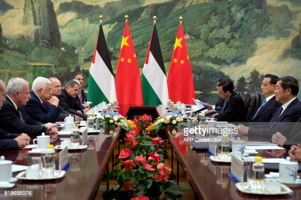 Palestinian President Mahmoud Abbas listens as Chinese Premier Li Keqiang speaks during a meeting at the Great Hall of the People in Beijing on July...