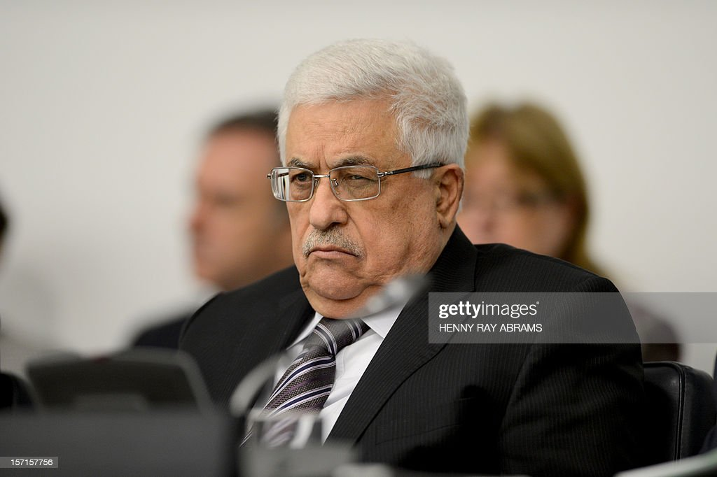 Palestinian President Mahmoud Abbas listens as Palestinian Foreign Minister Riyad al-Malki addresses the Committee on the Exercise of the Inalienable Rights of the Palestinian People, November 29, 2012 at UN headquarters in New York. AFP PHOTO/Henny Ray Abrams