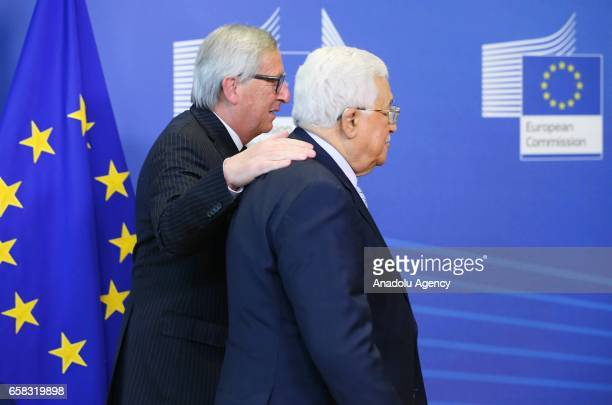 Palestinian President Mahmoud Abbas meets President of the European Commission JeanClaude Juncker in Brussels Belgium on March 26 2017
