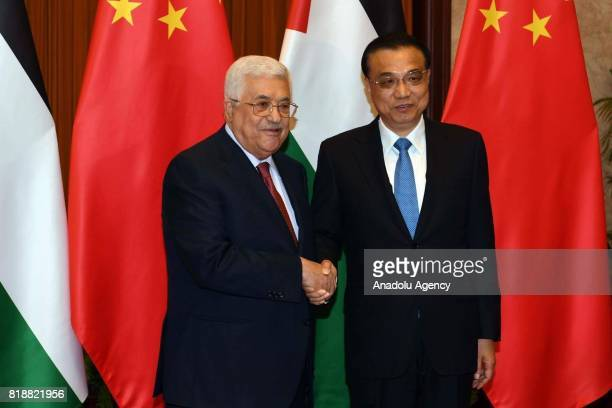 Palestinian President Mahmoud Abbas meets with Chinese Prime Minister Li Keqiang during his official visit in Beijing China on July 19 2017