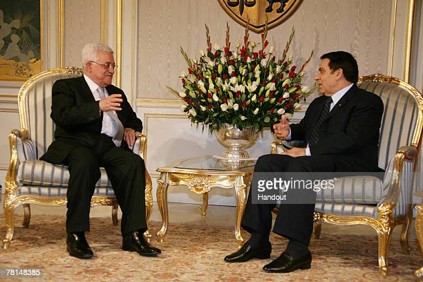 Palestinian President Mahmoud Abbas meets with President Zine El Abidine Ben Ali at the offices of the Almaqrati party during the International Day...