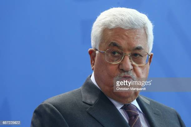 Palestinian President Mahmoud Abbas reacts while speaking to the media with German Chancellor Angela Merkel ahead of a common meeting at the...