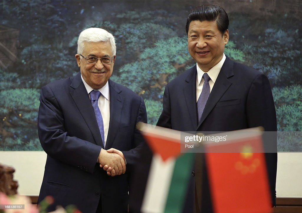 Palestinian President Mahmoud Abbas shakes hands with China's President Xi Jinping during their meeting at the Great Hall of the People on May 6, 2013 in Beijing, China. Abbas is visiting China from May 5 to 7.