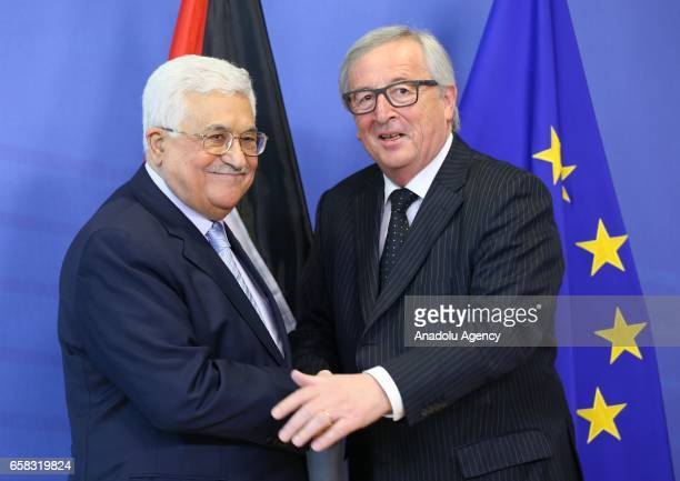 Palestinian President Mahmoud Abbas shakes hands with the President of the European Commission JeanClaude Juncker in Brussels Belgium on March 26 2017
