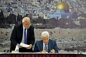 Palestinian President Mahmoud Abbas signs 20 international treaties including the Rome Statute of the International Criminal Court during the meeting...