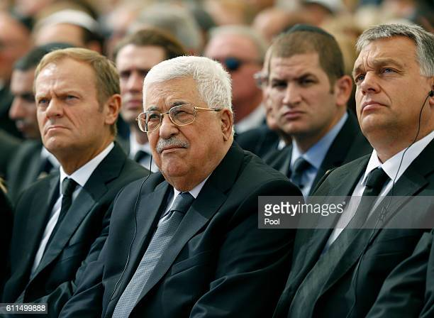 Palestinian President Mahmoud Abbas sits alongside European Council President Donald Tusk and President of Romania is Klaus Iohannis as they attend...