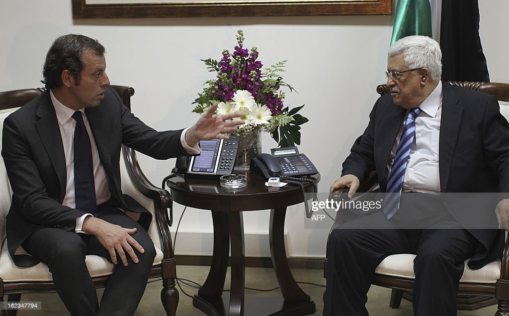 Palestinian President Mahmoud Abbas (R) talks with FC Barcelona football club's president Sandro Rosell (L) during a meeting at Abbas Office in the West bank city of Ramallah, on February 22, 2013. Rossll is visiting Israeli and Palestine to promote the idea of a joined football match between Barcelona and players from the Israeli and Palestinians national teams.