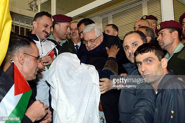 Palestinian president Mahmoud Abbas welcomes 18 of 26 Plaestinian prisoners released by Israel as part of the IsraeliPalestinian peace talks arriving...