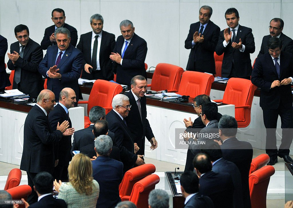 Palestinian president Mahmud Abbas (C) accompanied by Turkey's Prime Minister Tayyip Erdogan (centre top), greets Turkish lawmakers after making a speech at the Turkish Parliament ion December 10, 2012. The UN General Assembly overwhelmingly backed a resolution to recognise Palestine as a non-member observer state, a move Abbas said on December 5, 2012 was part of 'a last chance' for a negotiated two-state solution. Turkey welcomed the upgrading of the Palestinians' status as a 'significant step', with Foreign Minister Ahmet Davutoglu calling for an independent Palestinian state with east Jerusalem as its capital.